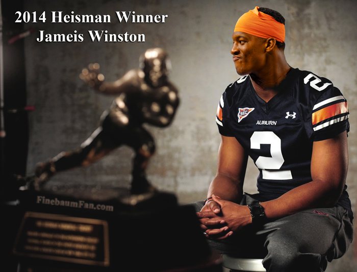 Jameis Winston admires his 2014 Heisman Trophy.