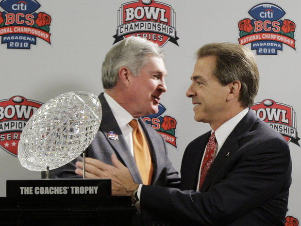 Mack Brown and Nick Saban share a smile before the 2010 BCS title game won by Alabama. (Associated Press file)